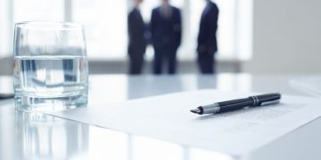 close-up-of-glass-of-water-and-pen_1098-3598-360x180